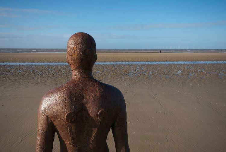 1280px-Behind_-_Another_Place,_Crosby_Beach.jpg