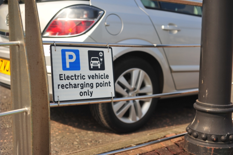 Electric_car_charging_point_-_road_signage.JPG