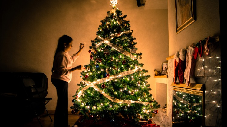 woman-decorating-ornamented-christmas-tree.jpg