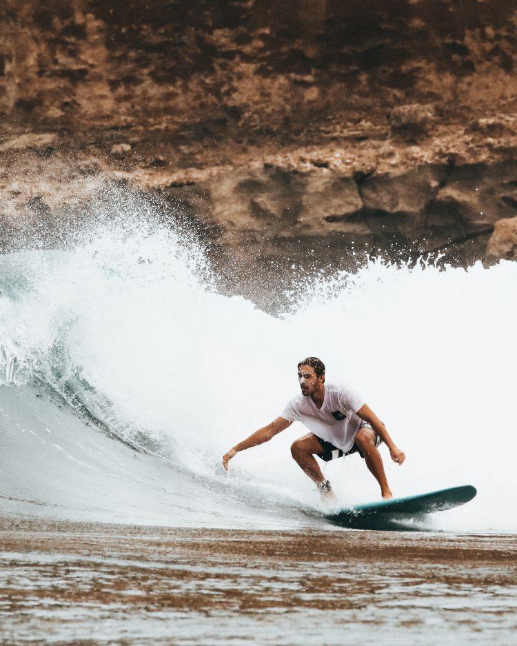 man-surfing-on-ocean-waves-1650732.jpg
