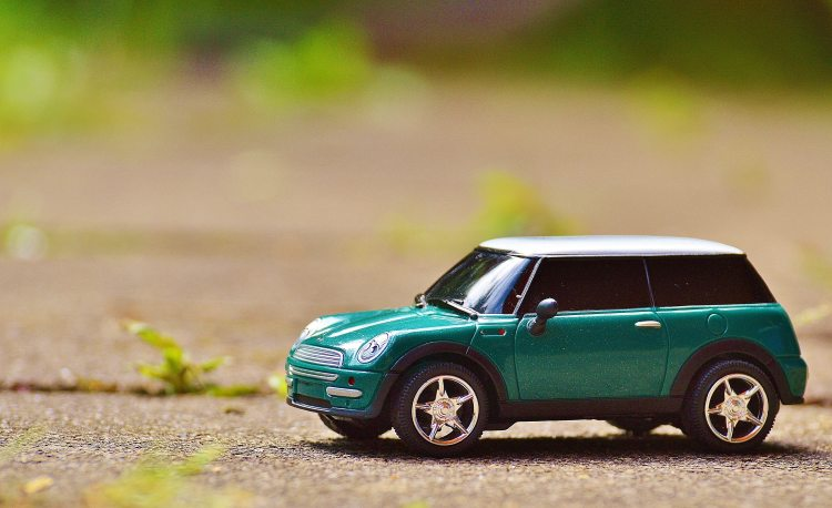 green-scale-model-car-on-brown-pavement-35967.jpg