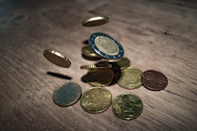 close-up-of-coins-on-table-332304.jpg