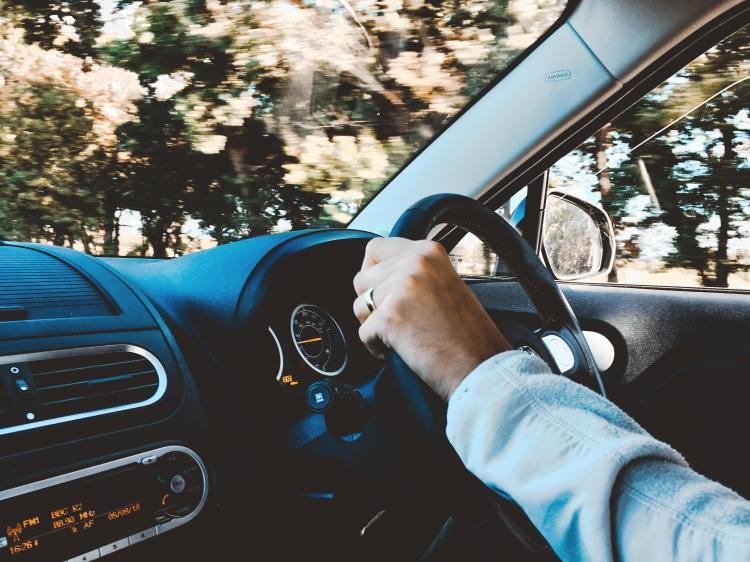 person-holding-black-vehicle-steering-wheel-1392621.jpg